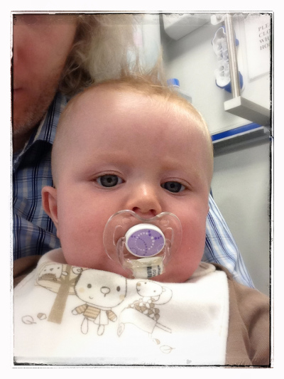 Chris and Mattie in Hospital on the last morning - trying hard to get some smiles from a tired baby
